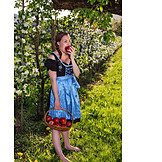 Young woman, Eating, Apple, Dirndl